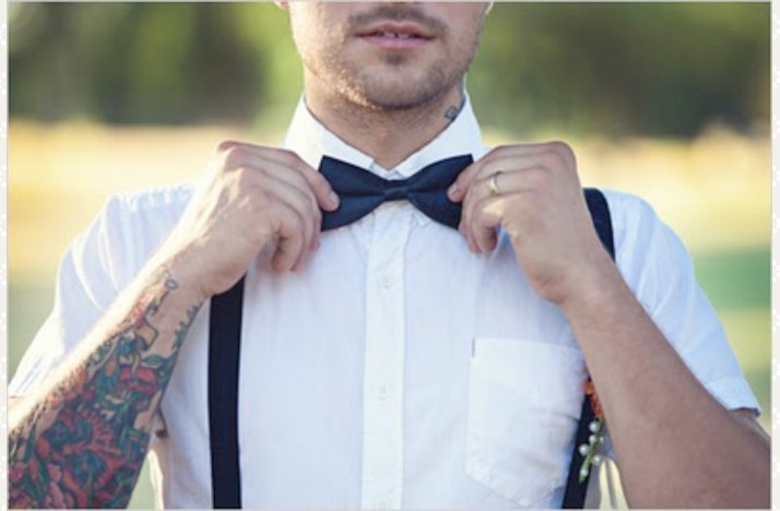 Edgy-groom-wears-bow-tie.full
