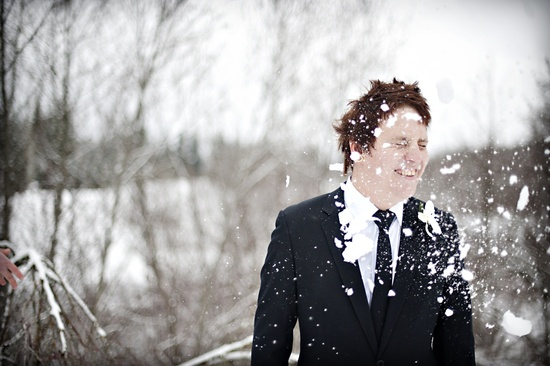 outdoor winter wedding photography offbeat groom snowball fight