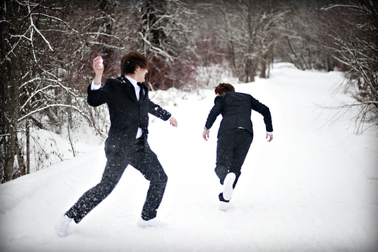 outdoor winter wedding photography snowball fight