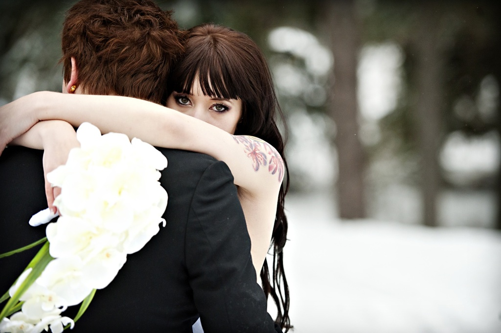 Outdoor-winter-wedding-photography-bride-hugs-groom-orchid-bridal-bouquet.full