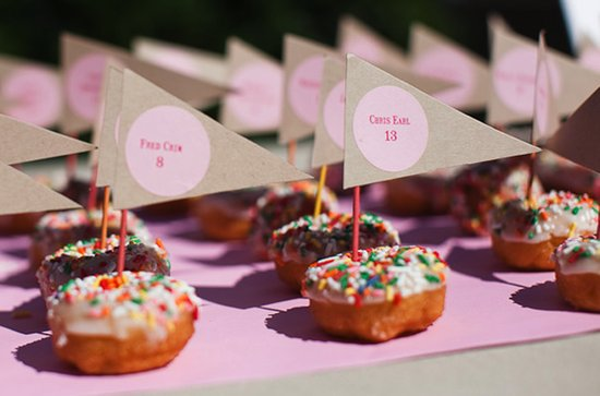 Creative donut wedding reception escort cards idea