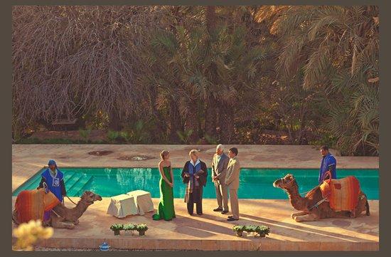 photo of desert wedding offbeat wedding style casual outdoor wedding poolside