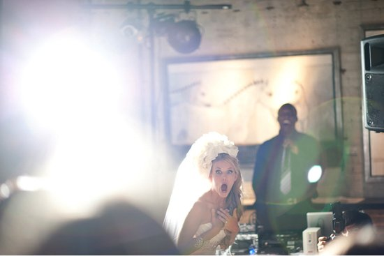 memorable wedding photos day of photography surprised bride at reception