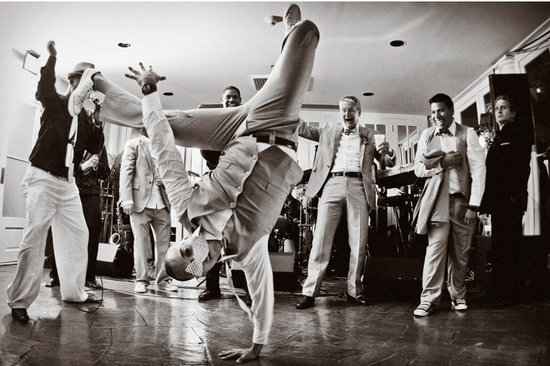 Breakdancing groom on the reception dance floor