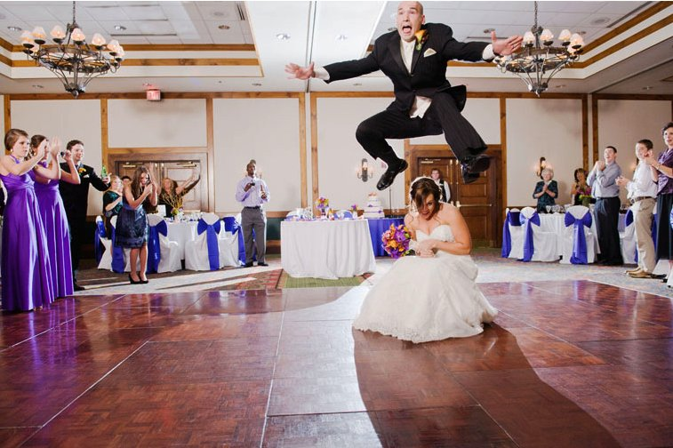 Memorable-wedding-photos-day-of-photography-groom-jumps-bride-during-first-dance.full
