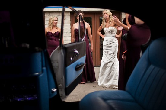 memorable wedding photography bride pouts outside of wedding car
