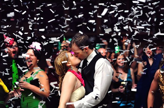 memorable wedding photography bride and groom showered with confetti