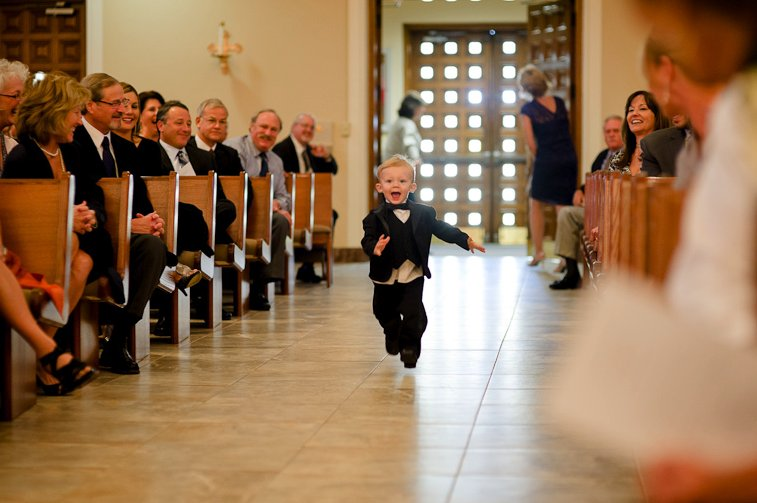 Memorable-wedding-photos-day-of-photography-ring-bearer-runs-down-aisle.full