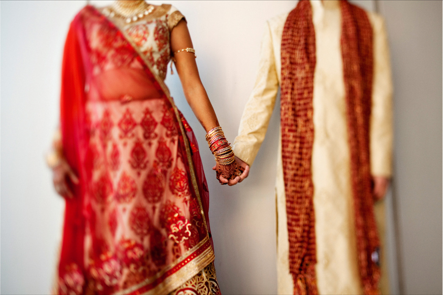 Multi-cultural-weddings-indian-bride-bride-groom-hold-hands.full