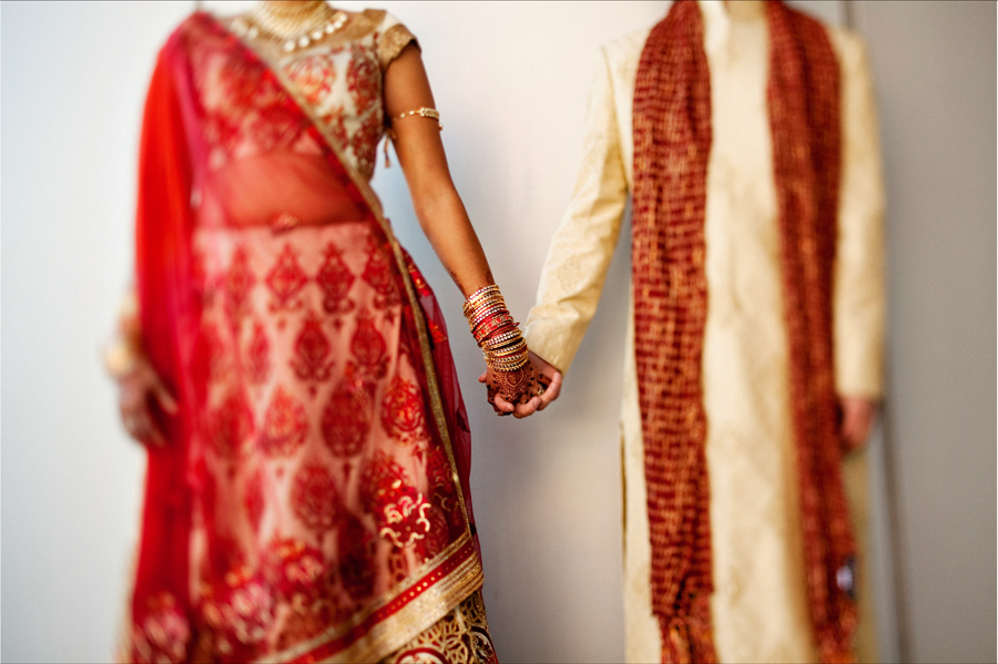 Multi-cultural-weddings-indian-bride-bride-groom-hold-hands.original