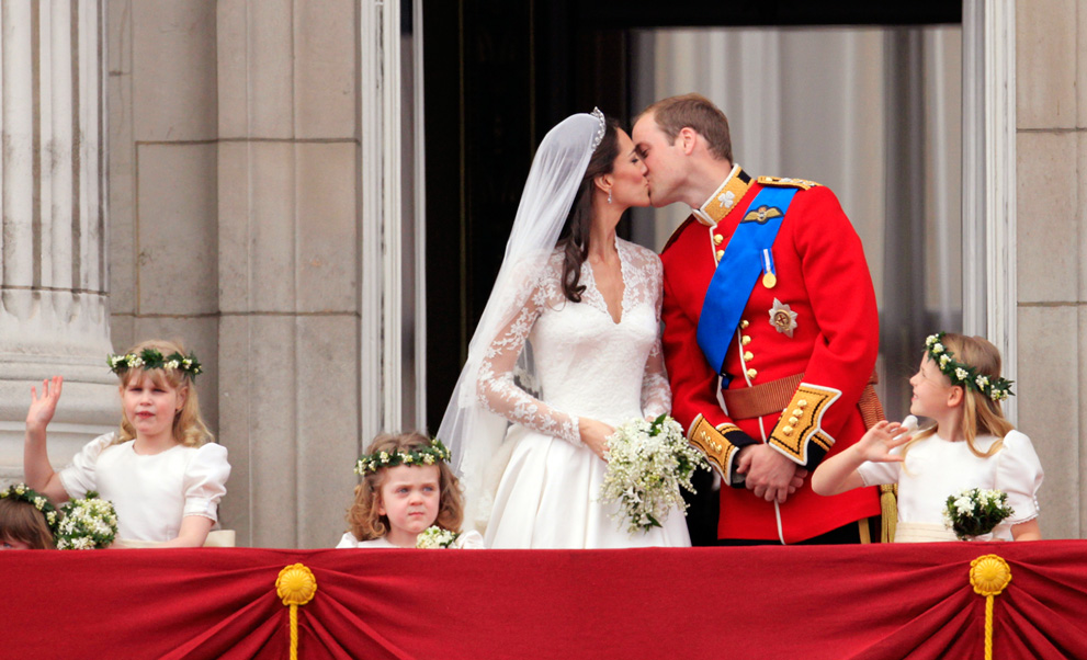Royal-wedding-up-close-first-kiss-flower-girls-look-on.original