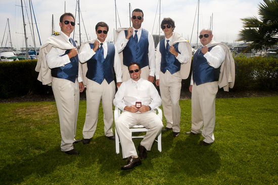 Groom and his party with off white suits and blue accents