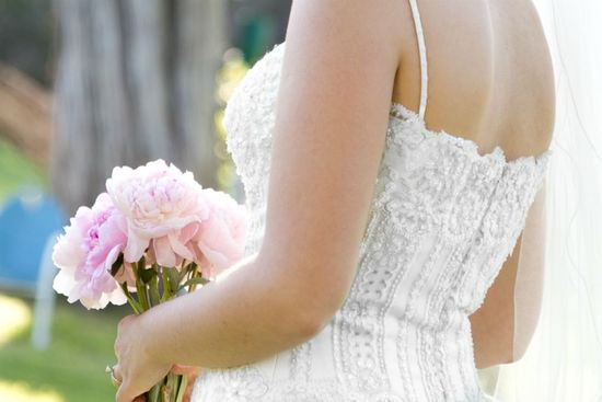 Spaghetti strap wedding gown and flowers