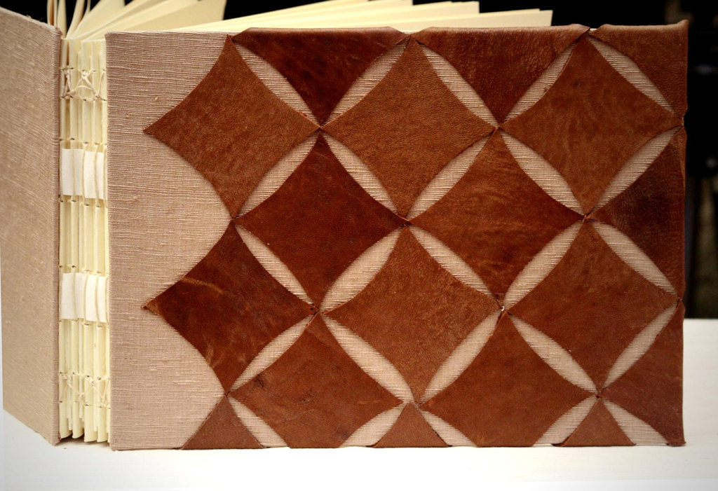 Artbychapin_leather_silk_cathedral_window_design4.full