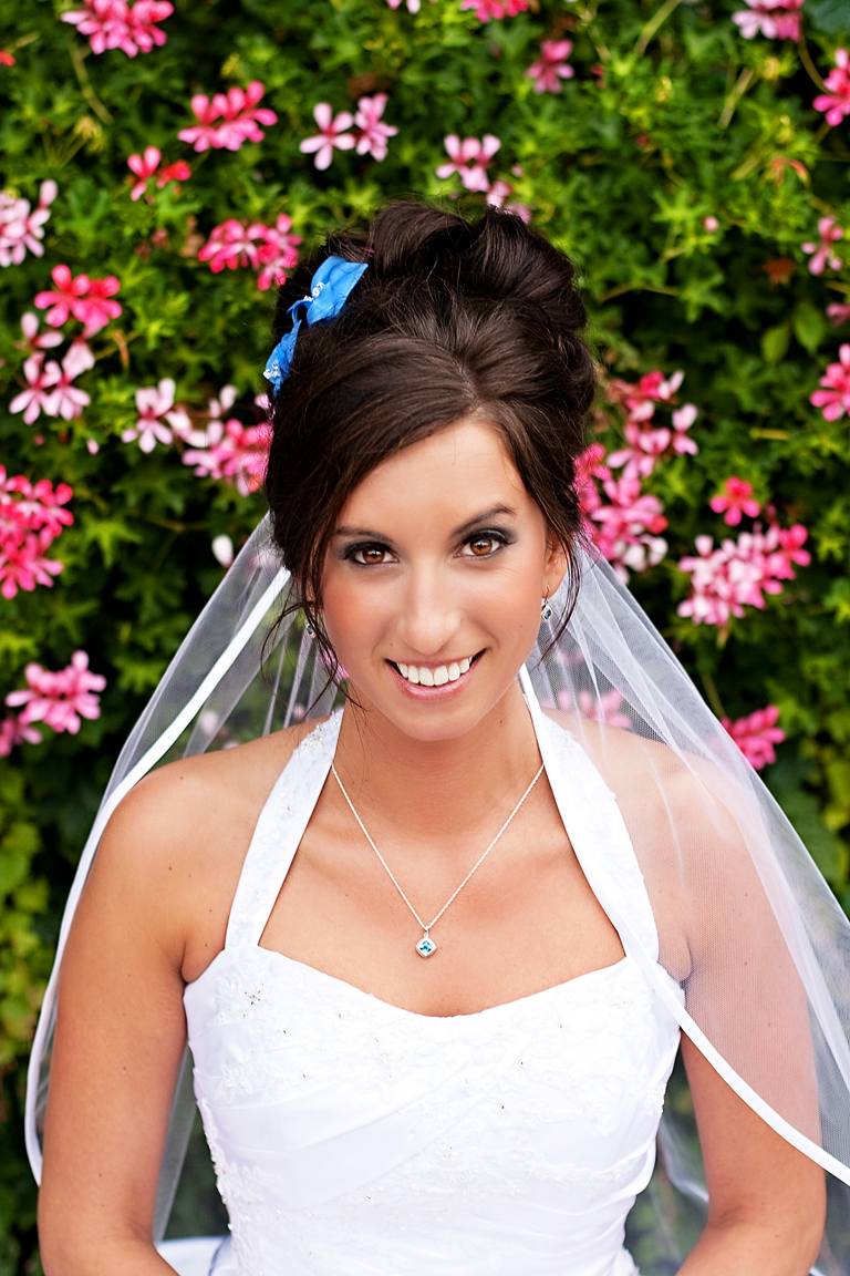 Bridal updo with blue bow