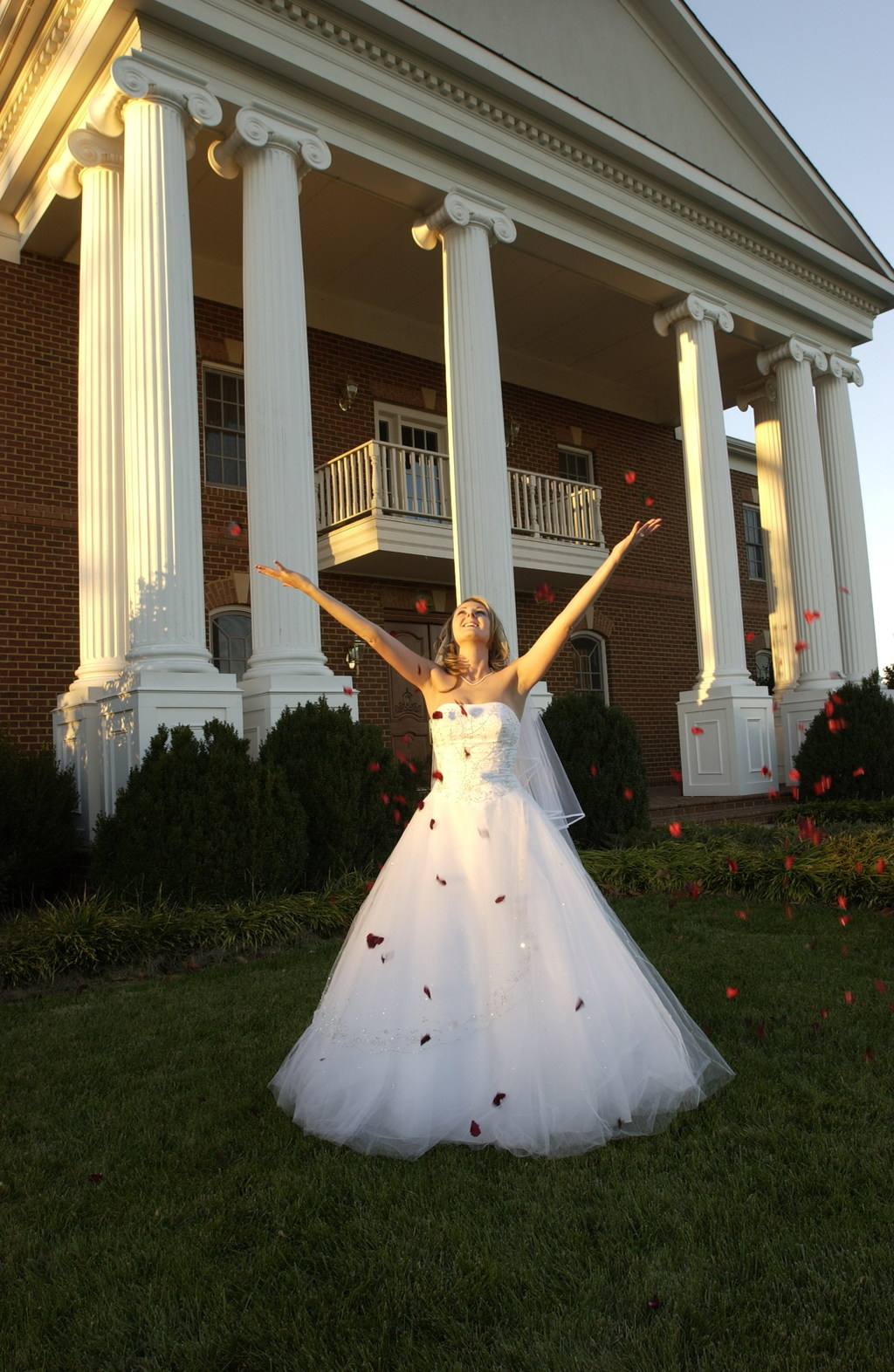 Bride throwing flowers in the air at RH