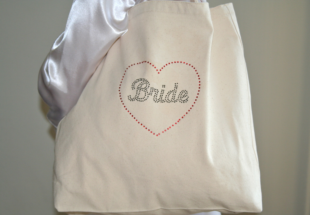 Tote%20bag%20close%20up%20with%20black%20rhinestones%20and%20white%20robe.full
