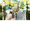 Whimsical-garden-wedding-green-yellow-paper-cranes-outdoor-kiss.square