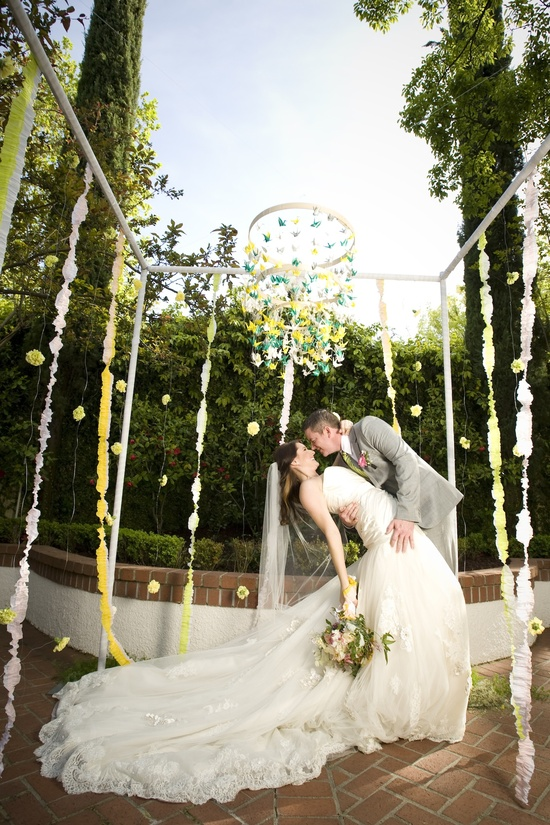 whimsical garden wedding outdoor venue bride groom kiss