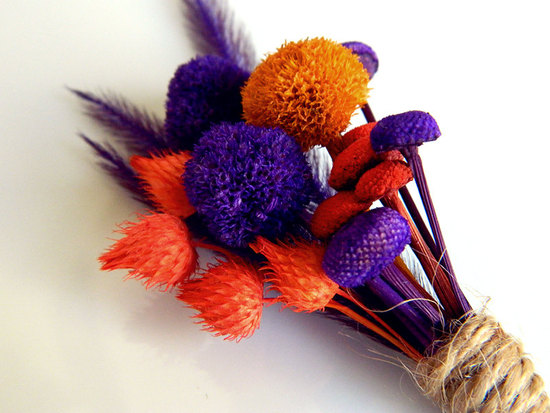 orange purple grooms boutonniere eco friendly wedding ideas