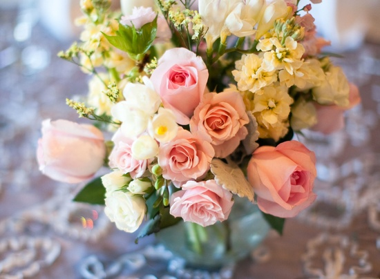 romantic real wedding soft pink roses ivory blooms centerpiece