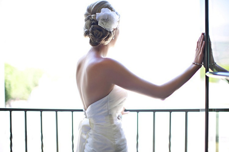 Wedding-hairstyles-we-love-bridal-updo-with-flower.full