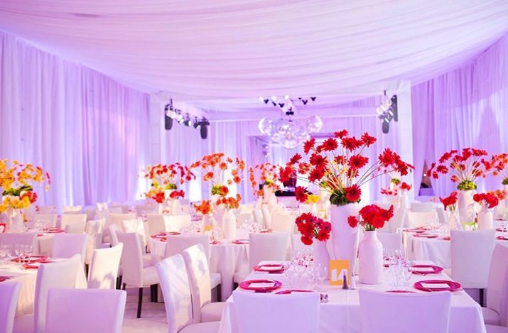 colorful wedding reception decor flowers lighting