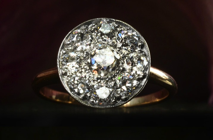 Unique-engagement-ring-vintage-disc-shaped-cluster.full
