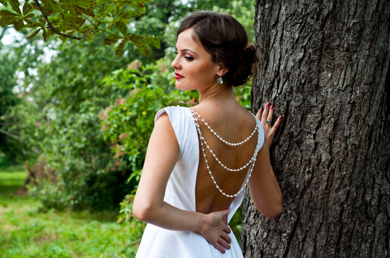 open back wedding dress strands of pearls