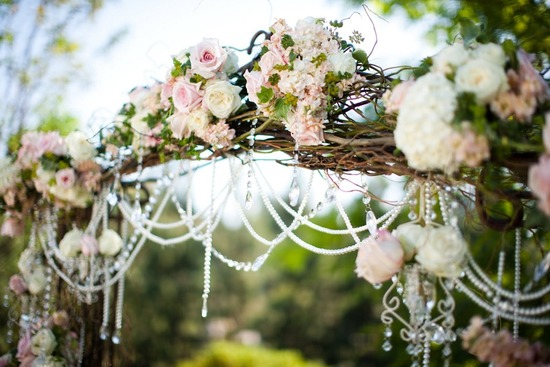 romantic wedding ceremony arbor bamboo roses