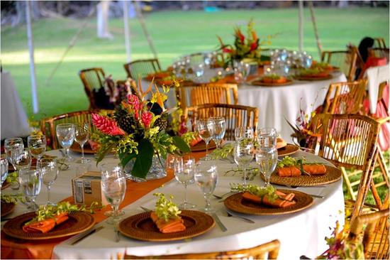 outdoor tropical featured wedding orange hot pink bamboo wedding reception tablescape