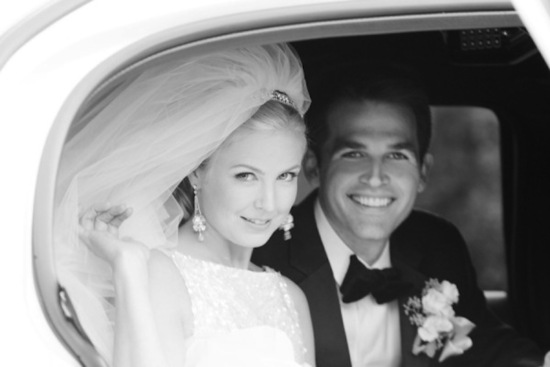 classic bride and groom in wedding car