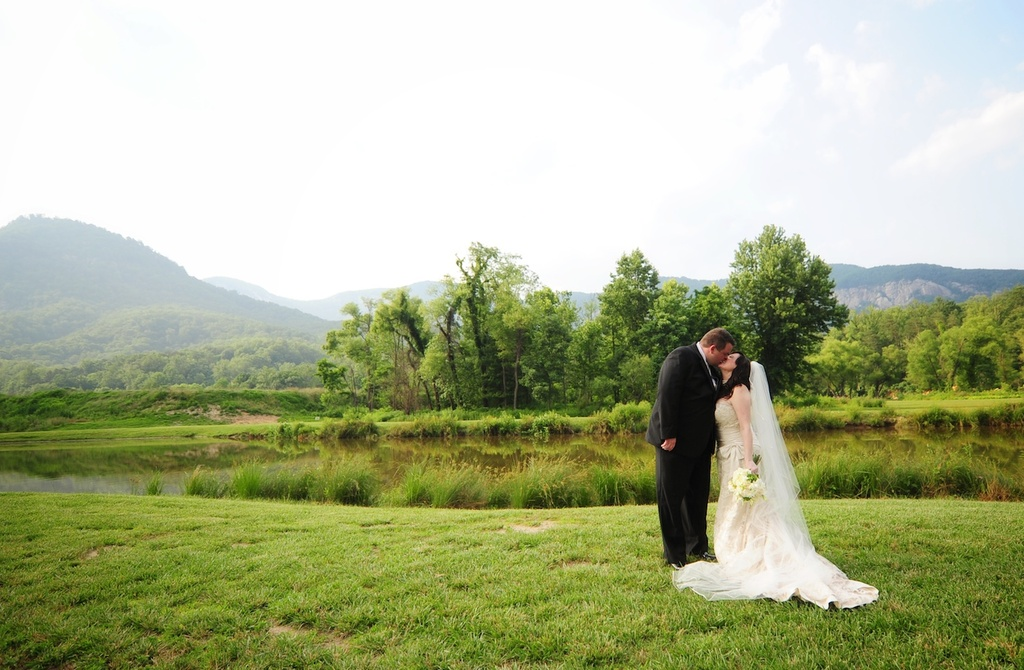 Bride-groom-kiss-at-outdoor-wedding-ceremony.full