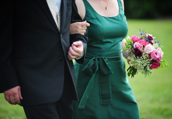 real wedding photography planning inspiration bridesmaid wears green dress rose bouquet