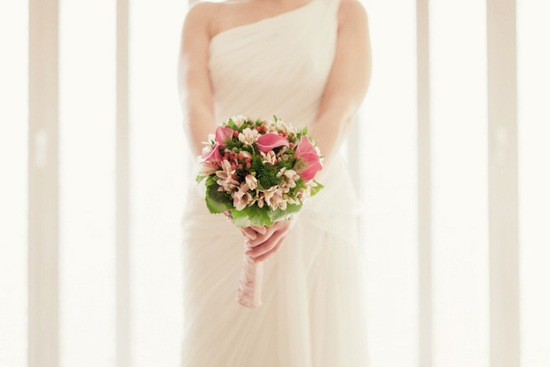 pink green bridal bouquet one shoulder wedding dress