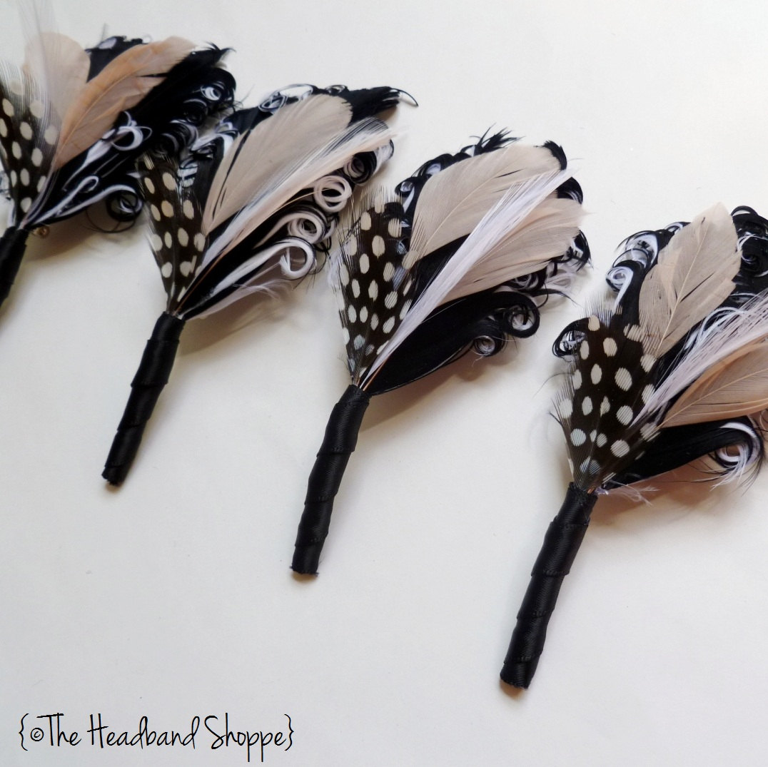 Black-ivory-feather-bouts-for-groom-groomsmen.original