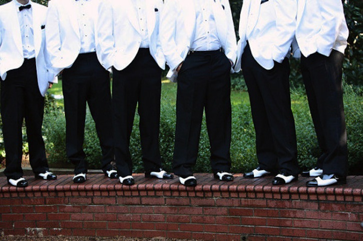 Elegant-charlotte-wedding-indoor-reception-venue-purple-lighting-groomsmen-black-white.full