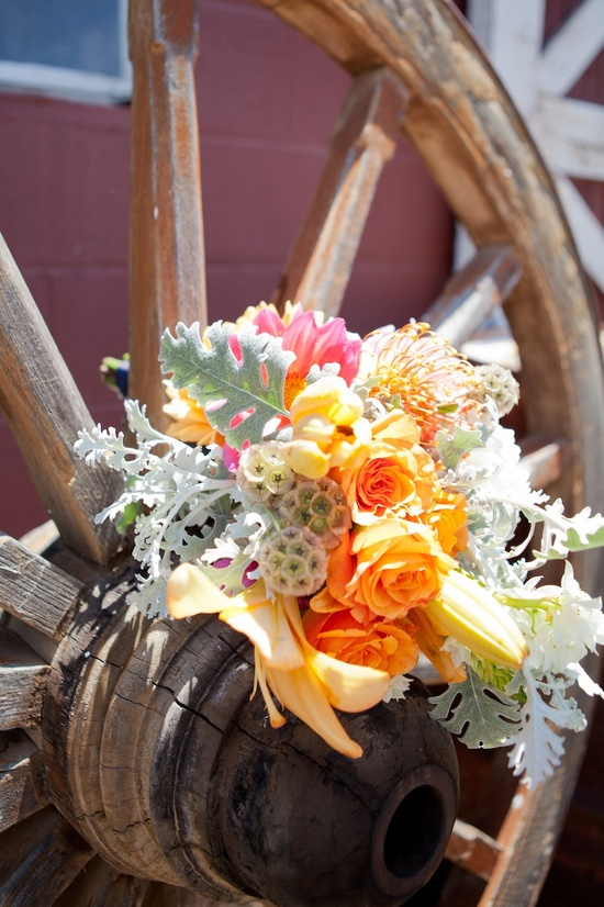 photo of orange sage green wedding flowers rustic bridal shower