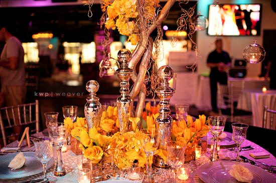 artistic wedding photography elegant indoor venue branchy centerpieces 2