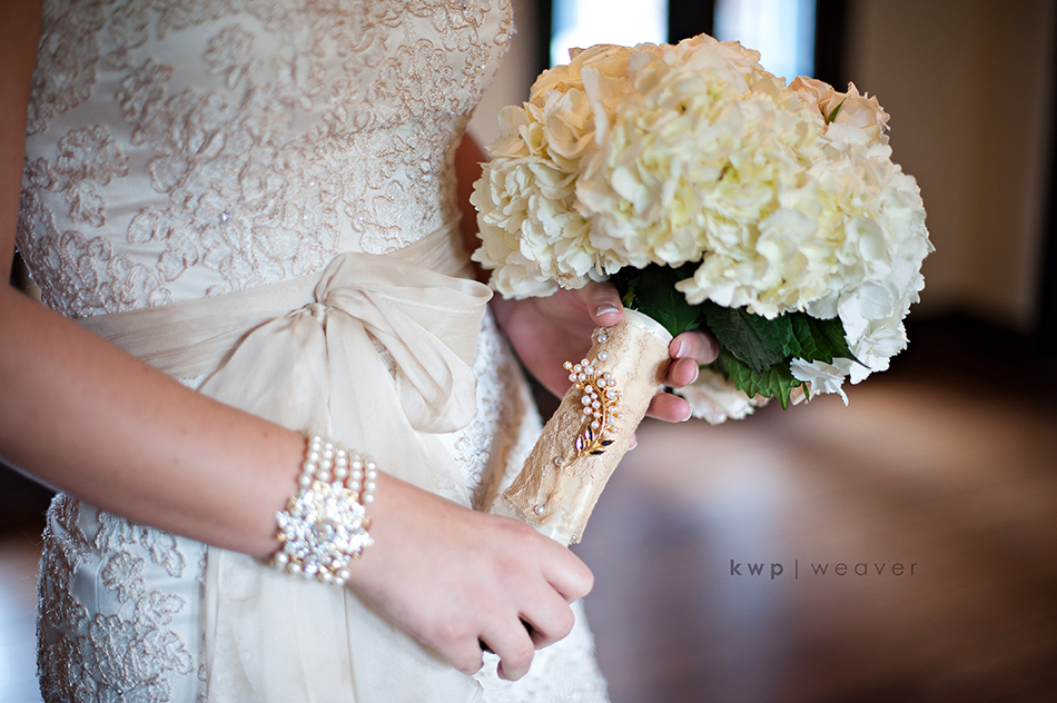 Real-wedding-detail-shot-reasons-to-splurge-on-the-wedding-photographer-brides-wedding-dress-bouquet.full