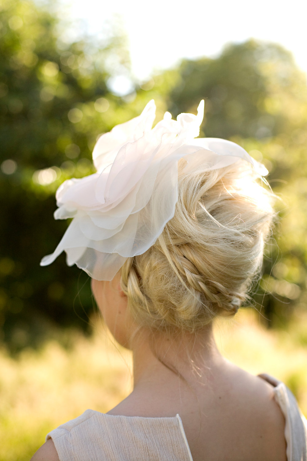 chic chignon bridal updo with romantic hair flower braid