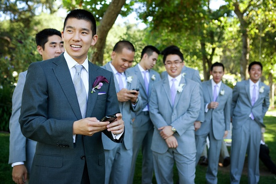 elegant California wedding with bold florals personalized details groom with groomsmen