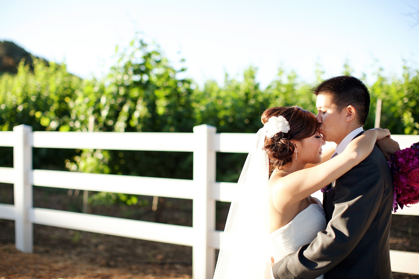 Bride-groom-kiss-at-malibu-california-wedding.original