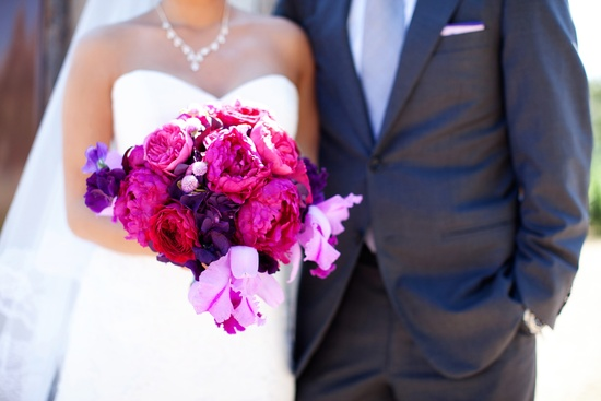 elegant California wedding with bold florals personalized details bride groom with bouquet