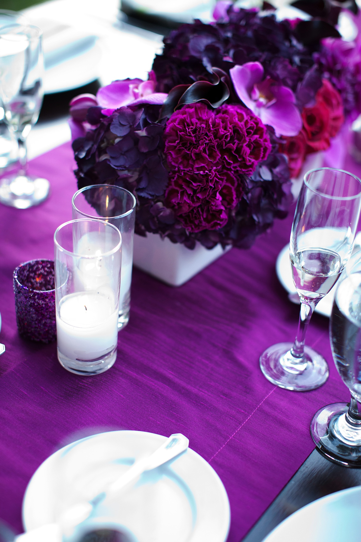 Romantic purple red fuschia wedding flower centerpieces