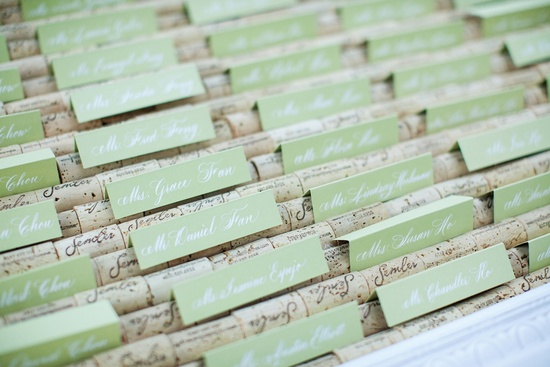 elegant wedding escort card display pastel green wine cork details