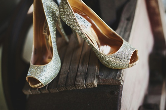 elegant malibu wedding with bold wedding flowers gold sparkle wedding shoes
