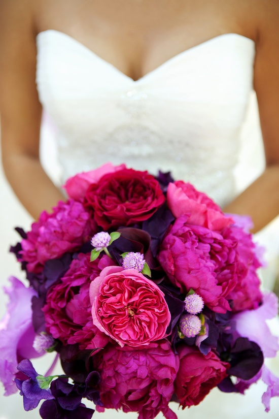 elegant malibu wedding with bold wedding flowers pink purple bridal bouquet