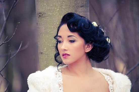 Retro waves wedding updo with flower accents