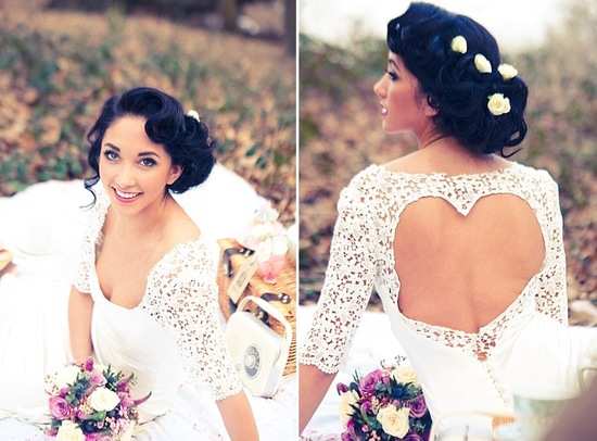 Retro waves wedding updo with flower accents and backless wedding dress